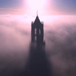 Gorgeous Drone Video of the Tallest Church Tower in the Netherlands Bursting Through a Sea of Fog